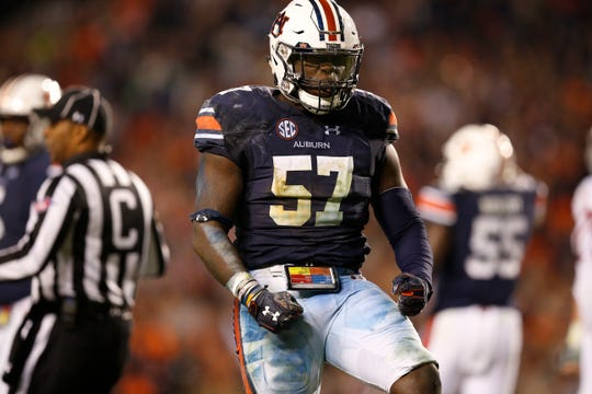 Auburn linebacker Deshaun Davis (57) celebrates during the second half of the Iron Bowl against Alabama, Saturday, Nov. 25, 2017, in Auburn, Ala.