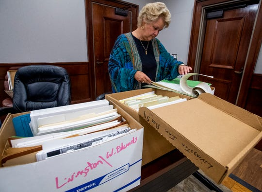 Former Montgomery County District Attorney Ellen Brooks looks through records of the Willie Edwards, Jr., murder while discussing her 1990's investigation into the 1957 murder in Montgomery, Ala., on Friday April 26, 2019.