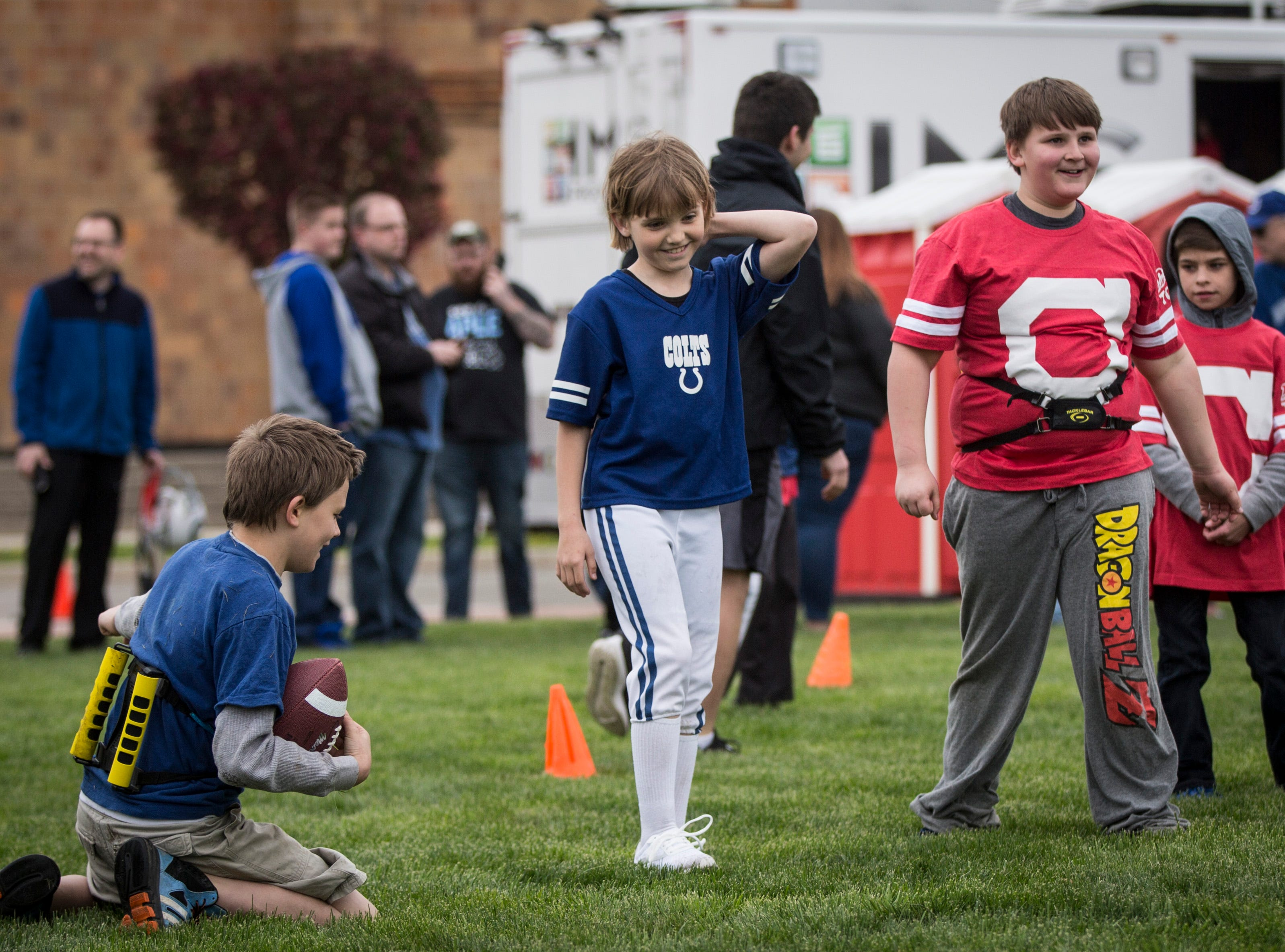 Kids take part in a mock football drill on April 27 during the Draft Day Tailgate event at Canan Commons. The event saw two live picks for the NFL draft in addition to family fun.