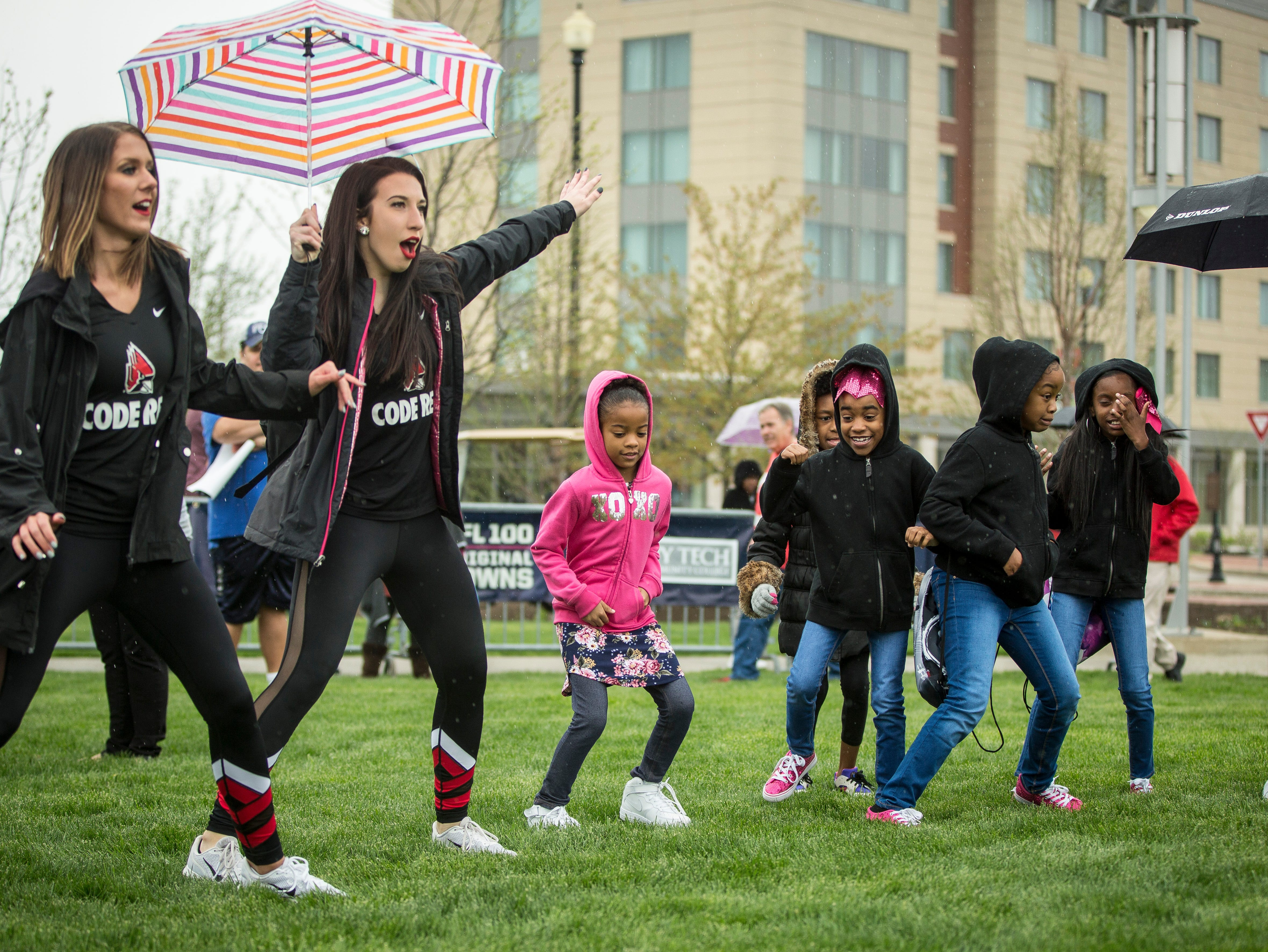 Kids dance, play catch and more on April 27 during the Draft Day Tailgate event at Canan Commons. The event saw two live picks for the NFL draft in addition to the family fun.