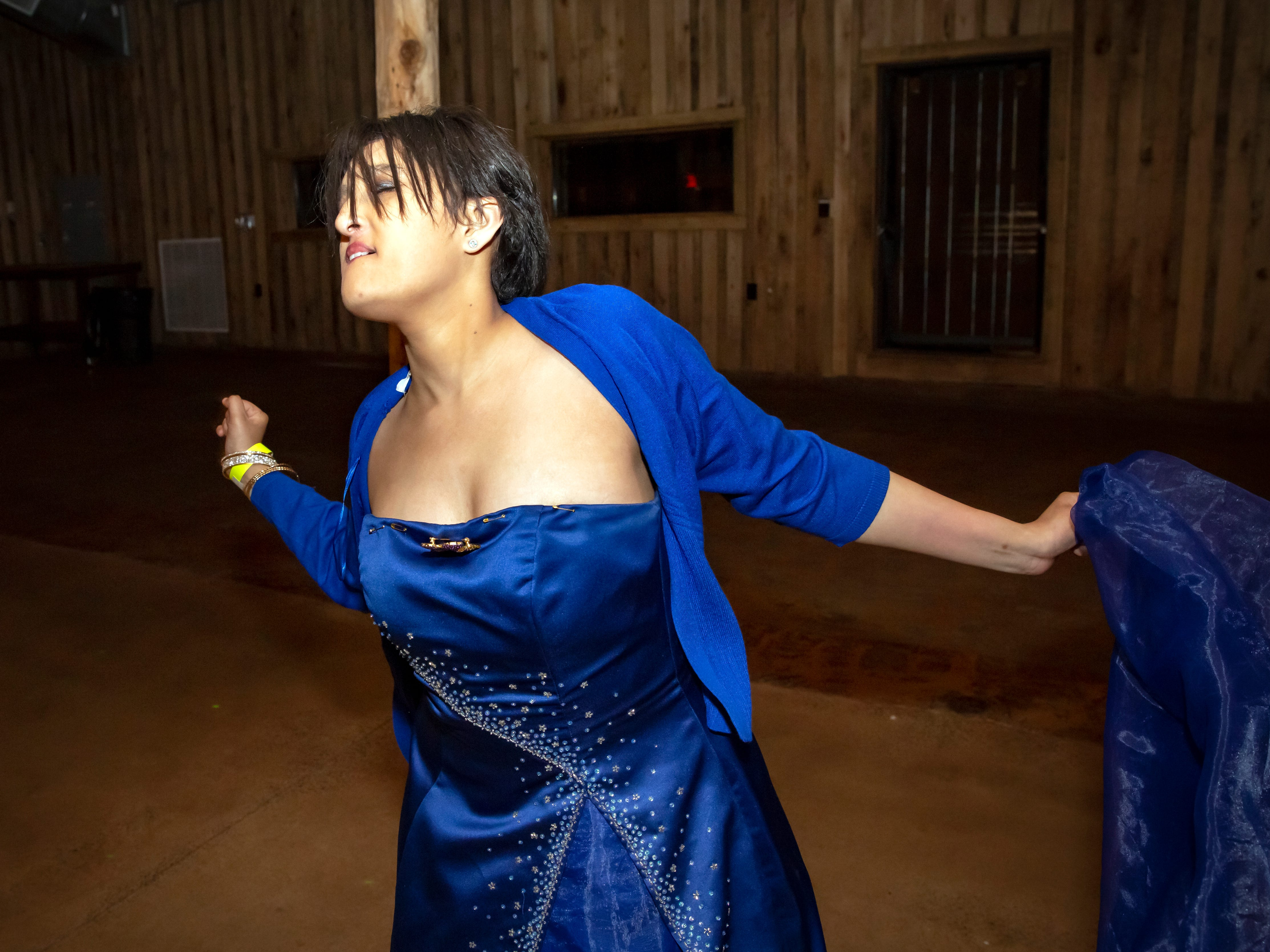 Becki Robinson dances to the music at the Smyrna High School prom held at the Grove, Friday, April 26, 2019.