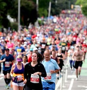 Runners come up a hill on Music Square East during the 20th annual St. Jude Rock 'n' Roll Nashville Marathon on Saturday, April 27, 2019, in Nashville, Tennessee.