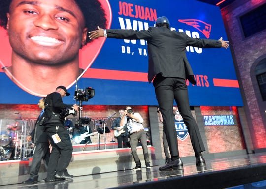 Vanderbilt's Joejuan Williams looks up at his face on the screen after being picked by the New England Patriots during the second day of the NFL Draft Friday, April 26, 2019, in Nashville, Tenn.