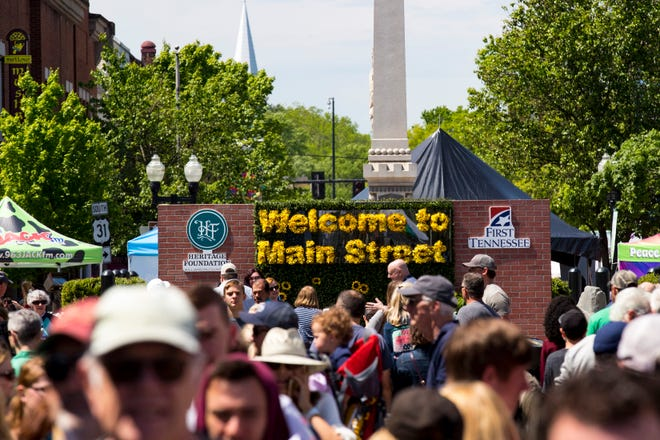 A sign on Franklin Square welcomes visitors to Main Street during the 36th annual Main Street Festival in Franklin on April 27, 2019.