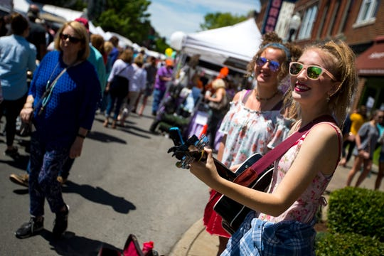 Hanna Ross, right, and her sister Madge Ross perform as Hanna x Madge during the 36th annual Main Street Festival in Franklin on April 27.