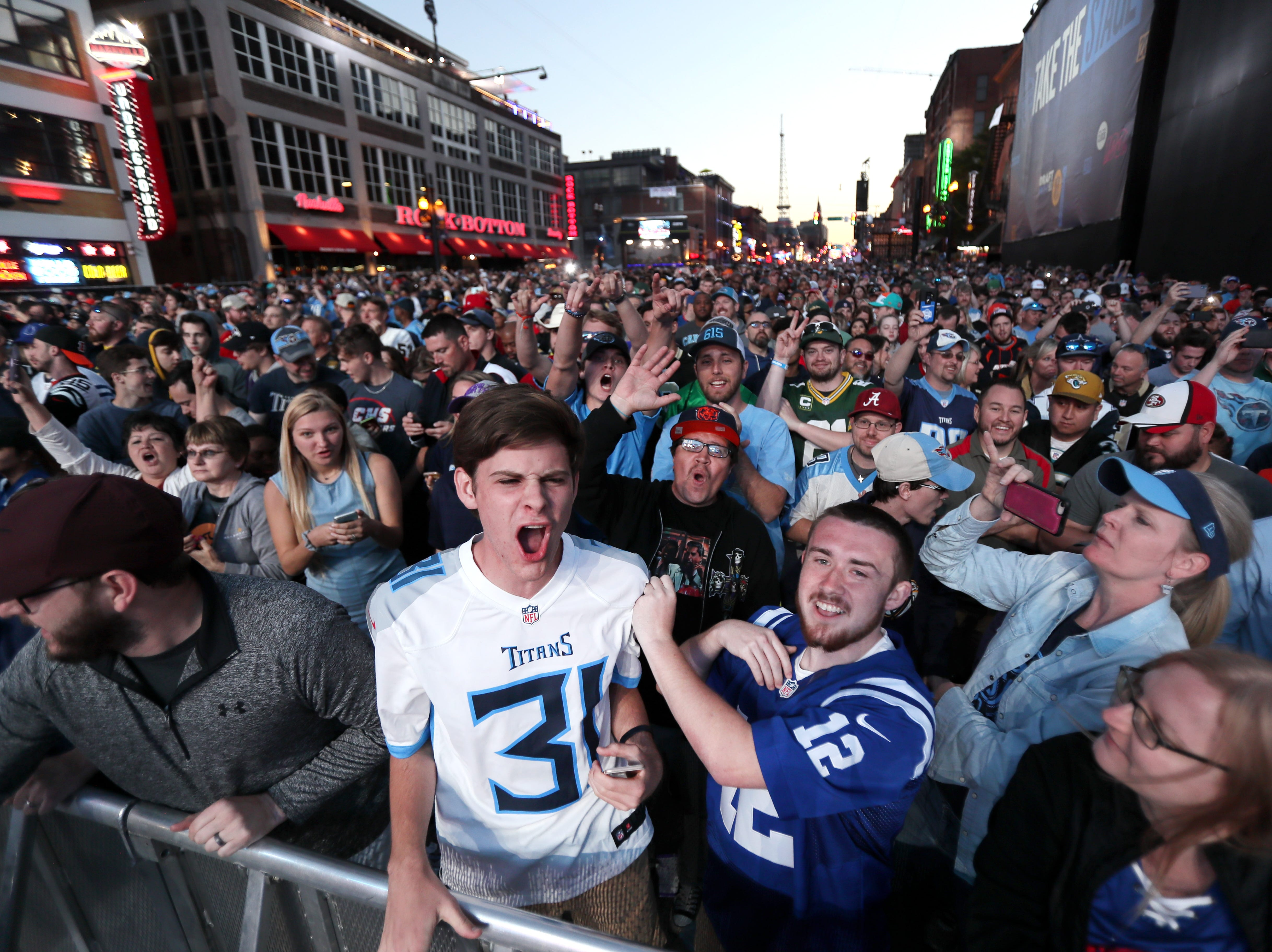 Colt Smith, center, celebrates the Titans second round selection of Ole Miss receiver A.J. Brown with his friend Nathan Bess during the NFL draft's second night on Lower Broadway in downtown Nashville on Friday, April 26, 2019.