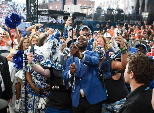 Reggie Wayne does a selfie with Colts fans during the second day of the NFL Draft Friday, April 26, 2019, in Nashville, Tenn.
