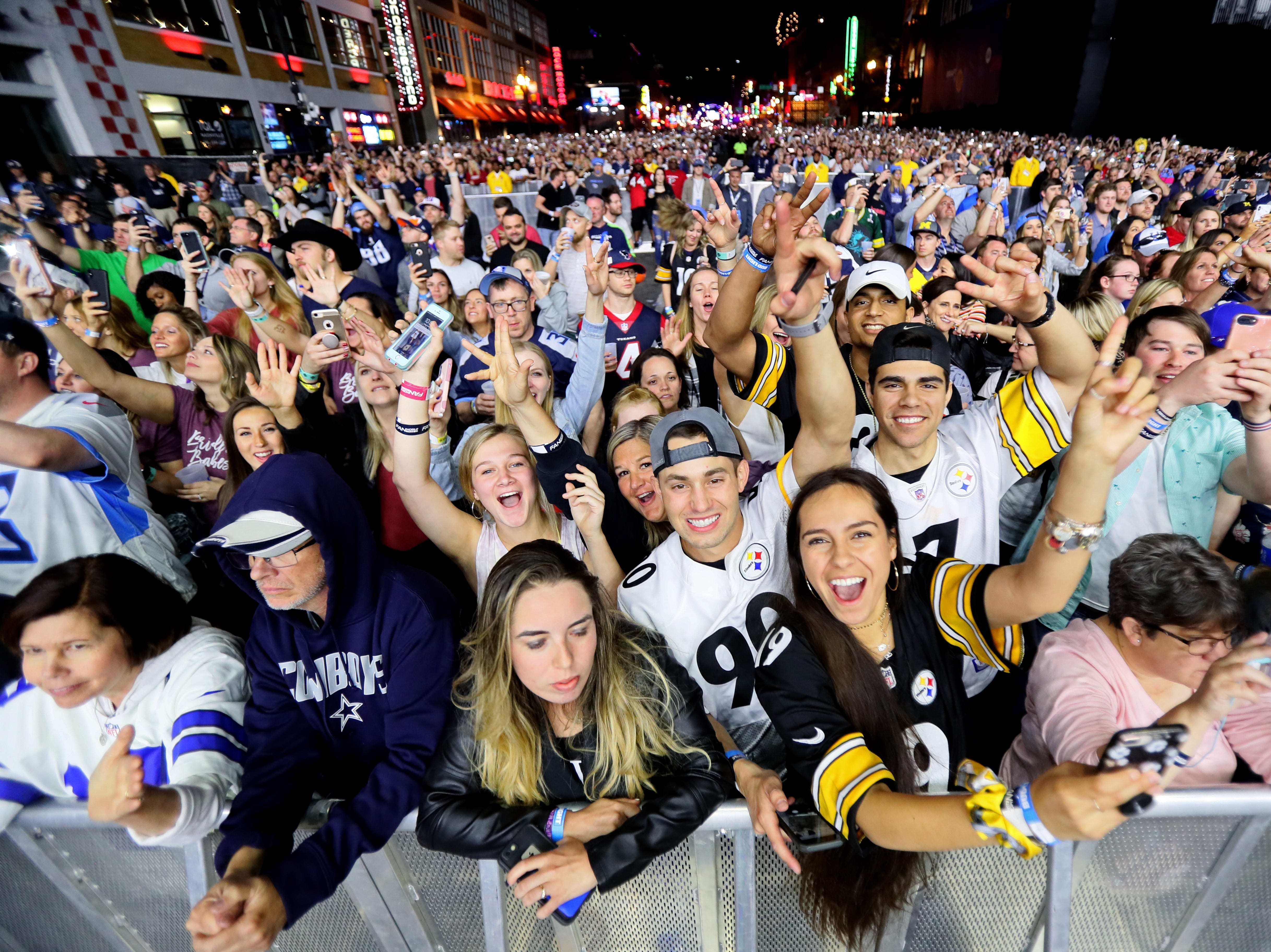 Fans listen as Tim McGraw performs after the NFL draft's second night on Lower Broadway in downtown Nashville on Friday, April 26, 2019.