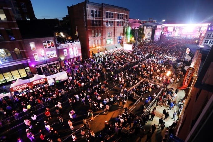 Fans crowd Lower Broadway during the NFL draft's second night in downtown Nashville on Friday, April 26, 2019.