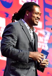 Dont'a Hightower announces the Patriots' pick of Vanderbilt's Joejuan Williams during the second day of the NFL Draft Friday, April 26, 2019, in Nashville, Tenn.