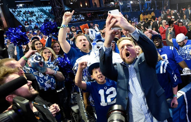 Former Colts punter Pat McAfee takes a selfie with fans after making the team's pick during the second day of the NFL Draft Friday, April 26, 2019, in Nashville, Tenn.