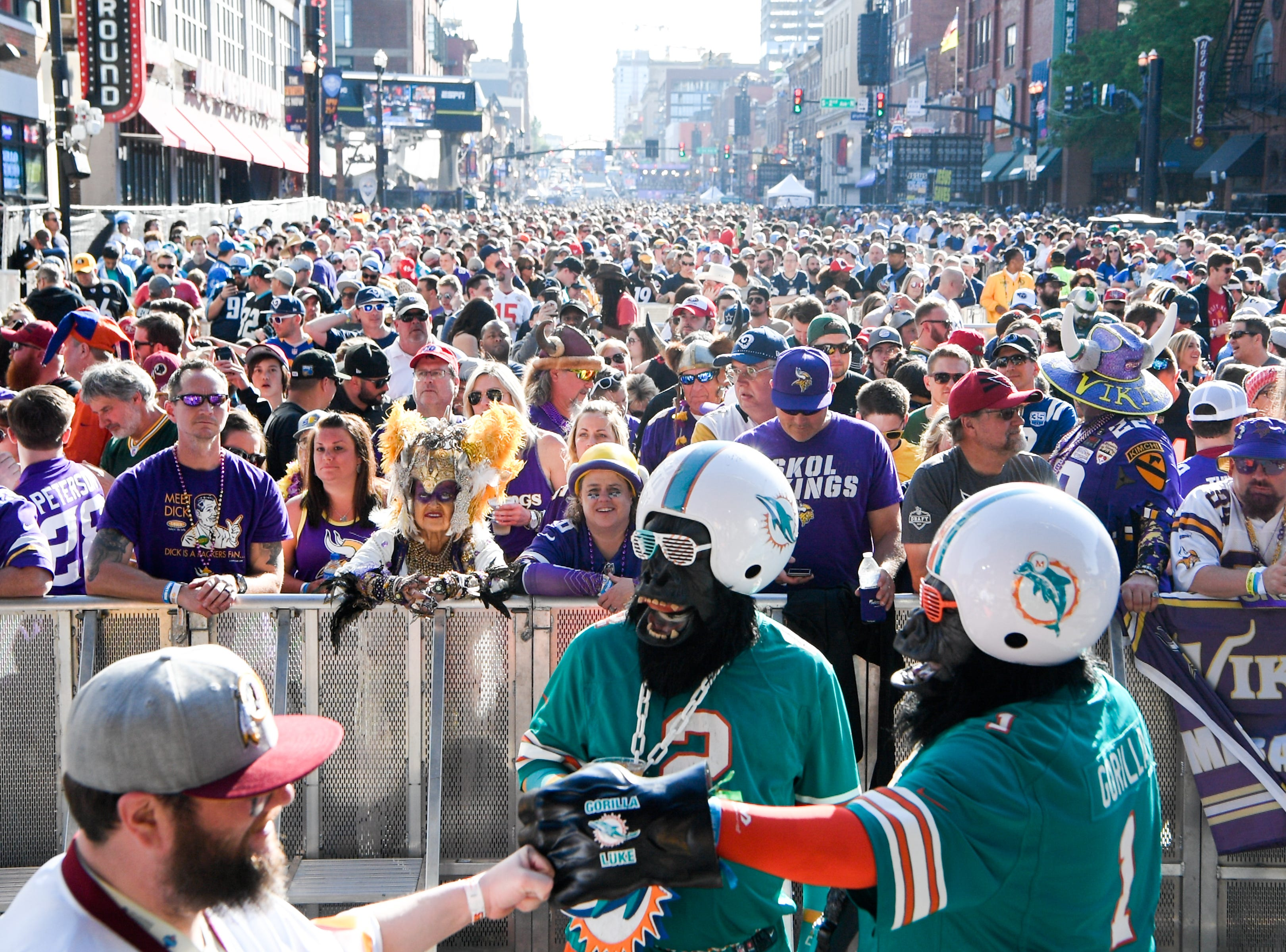 Fans gather on Lower Broadway during the NFL Draft Friday, April 26, 2019, in Nashville, Tenn.