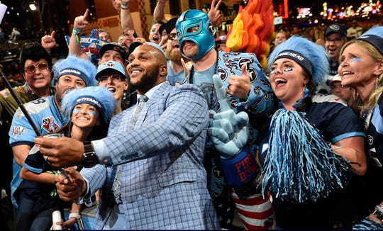 Titans defensive end Jurrell Casey takes a selfie with fans after making the team's pick of Nate Davis of Charlotte during the second day of the NFL Draft Friday, April 26, 2019, in Nashville, Tenn.