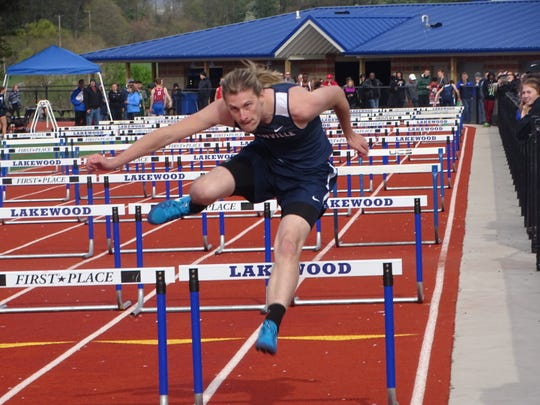 Granville's Craig Zies competes in the shuttle hurdles during last Friday's Sarah Robinson Relays at Lakewood.