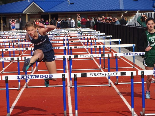 Granville's Katelyn Messner competes in the shuttle hurdles during last Friday's Sarah Robinson Relays at Lakewood.