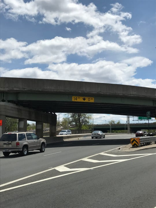 A man in his mid-20s suffered broken legs after jumping from the 14-foot overpass onto Route 20.