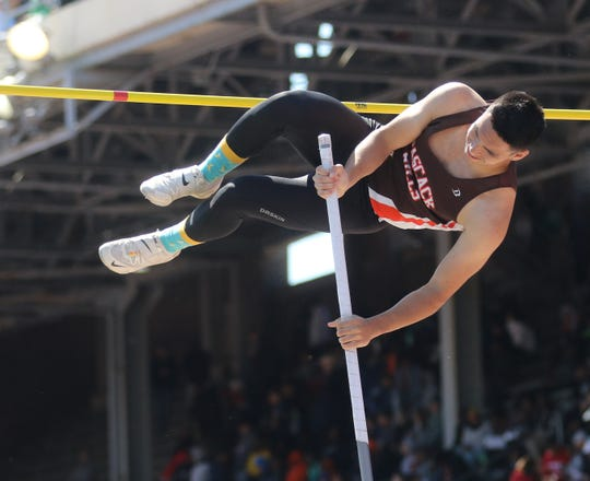 Liam Landau of Pascack Hills competing in the pole vault.