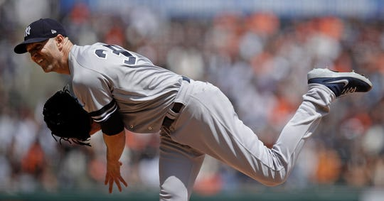 New York Yankees pitcher J.A. Happ works against the San Francisco Giants in the first inning of a game Saturday, April 27, 2019, in San Francisco.