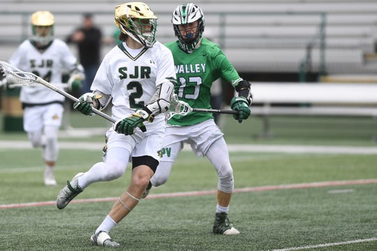Pascack Valley lacrosse at St. Joseph on Saturday, April 27, 2019. SJ #2 Ryan Stefanik tries to get past PV #13 Seth Weinstein.