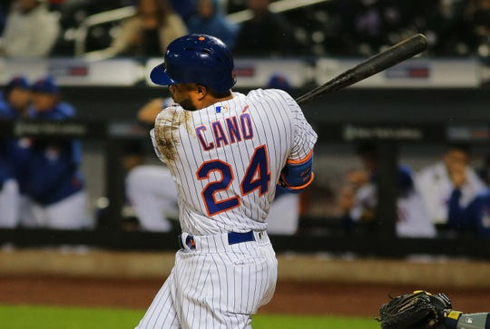 Apr 26, 2019; New York City, NY, USA; New York Mets second baseman Robinson Cano (24) doubles against the Milwaukee Brewers during the first inning at Citi Field.