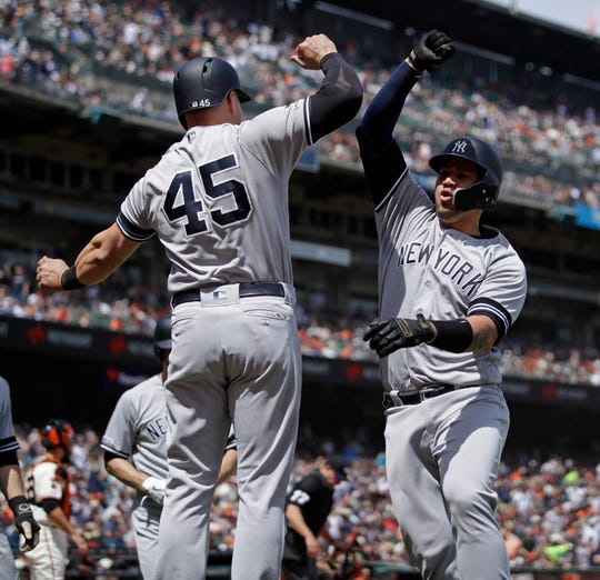 New York Yankees' Gary Sanchez, right, celebrates with Luke Voit (45) after hitting a grand slam off San Francisco Giants' Derek Holland in the fifth inning of a game Saturday, April 27, 2019, in San Francisco.