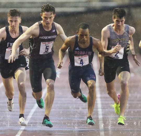 Will Baginski of Ridgewood (5) and Luis Peralta of Passaic (4) at the start of the High School Boys' Mile Run Championship at the Penn Relays on Friday, April 26, 2019.