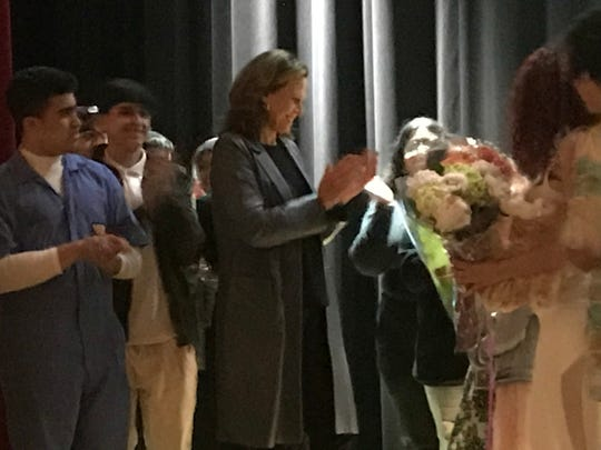 """Sigourney Weaver, center, receiving flowers from the cast of """"Alien"""" at North Bergen High School on Friday, April 26, 2019. The high school students were putting on an encore of their enormously popular production of the play based on the films Weaver starred in."""