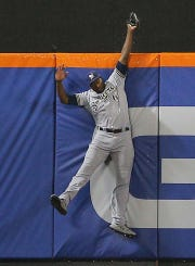 Apr 26, 2019; New York City, NY, USA; Milwaukee Brewers center fielder Lorenzo Cain (6) makes a leaping catch against the New York Mets during the second inning at Citi Field.