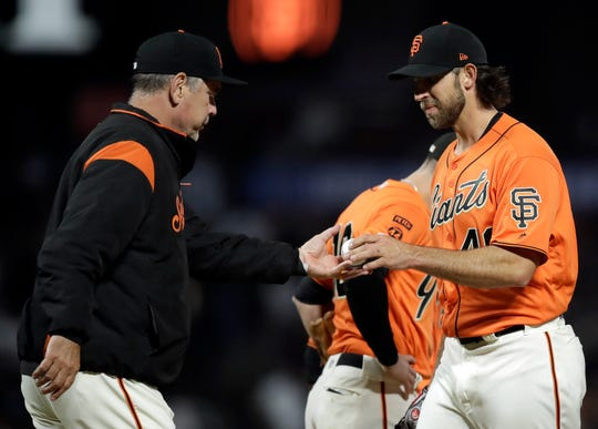 San Francisco Giants' Madison Bumgarner, right, hands the ball to manager Bruce Bochy as he is relieved in the sixth inning of a game against the New York Yankees Friday, April 26, 2019, in San Francisco.