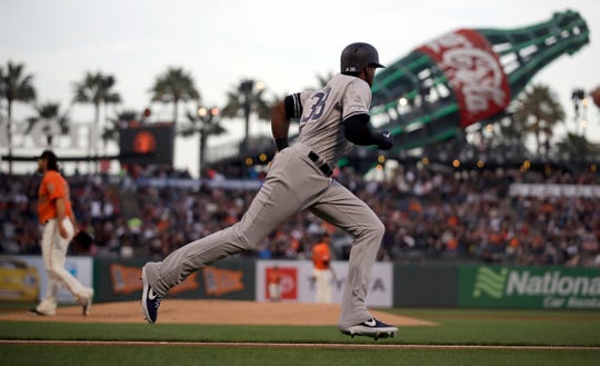 New York Yankees' Jonathan Loaisiga runs to first base after hitting an RBI single off San Francisco Giants' Madison Bumgarner in the first inning of a game Friday, April 26, 2019, in San Francisco.