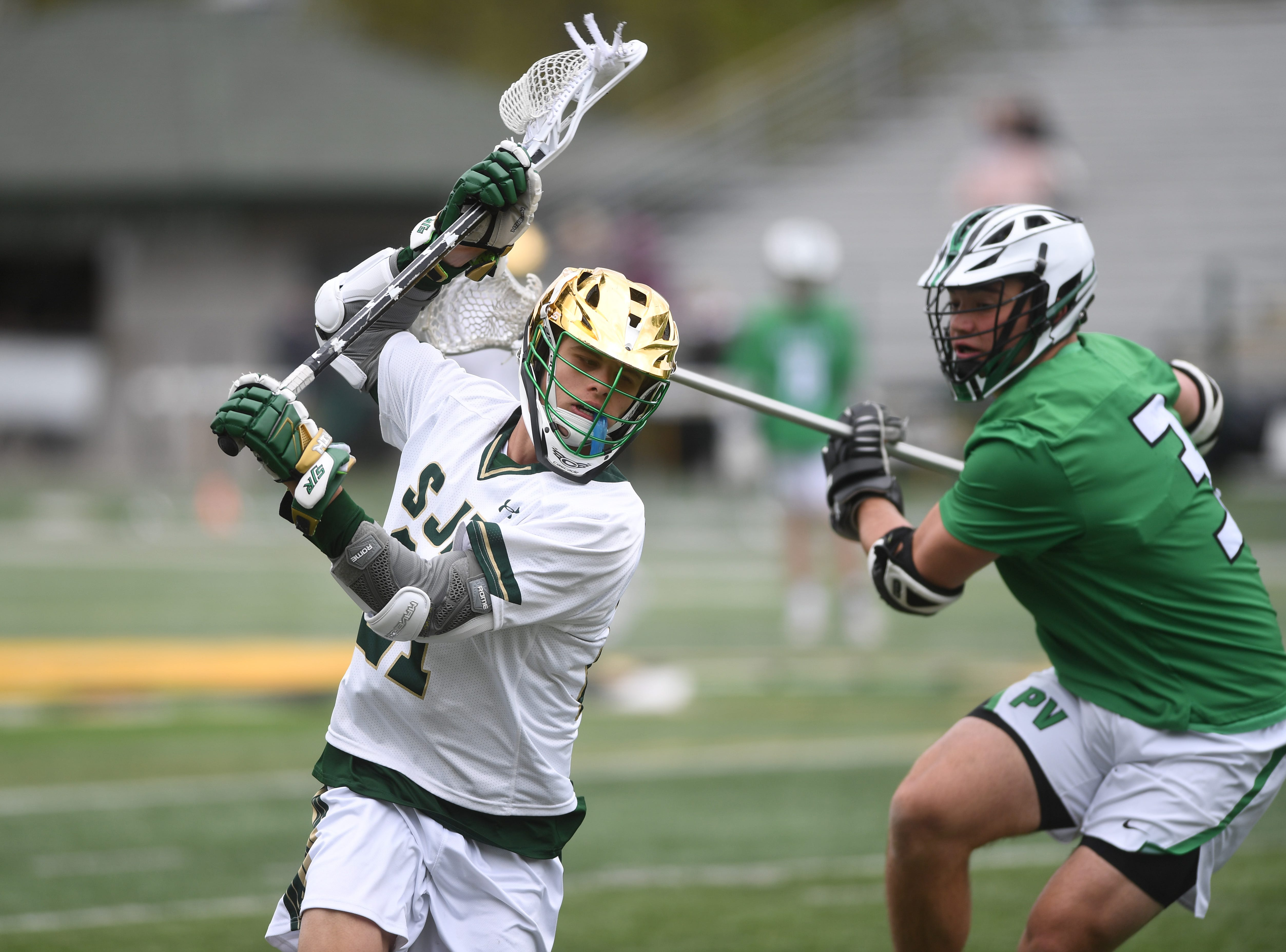 Pascack Valley lacrosse at St. Joseph on Saturday, April 27, 2019. SJ #21 Dom Delponte tries to get past PV #3 Charlie Looes.