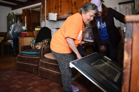 Anna Bures opens her new oven as Gail Stocks looks on in the kitchen of Bures' home in Fair Lawn on Saturday, April 27, 2019. Bures has medical issues such as macular degeneration, heart failure, arthritis and bone-on-bone knees which render her unable to climb the stairs and use the second floor of her home. Rebuilding Together North Jersey is a volunteer organization that provides home repairs to low-income homeowners at no charge. They focus on repairs that improve safety, eliminate health risks or make surroundings more accessible.