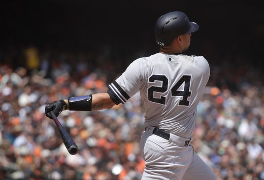 New York Yankees' Gary Sanchez swings for a grand slam off San Francisco Giants' Derek Holland in the fifth inning of a baseball game Saturday, April 27, 2019, in San Francisco.