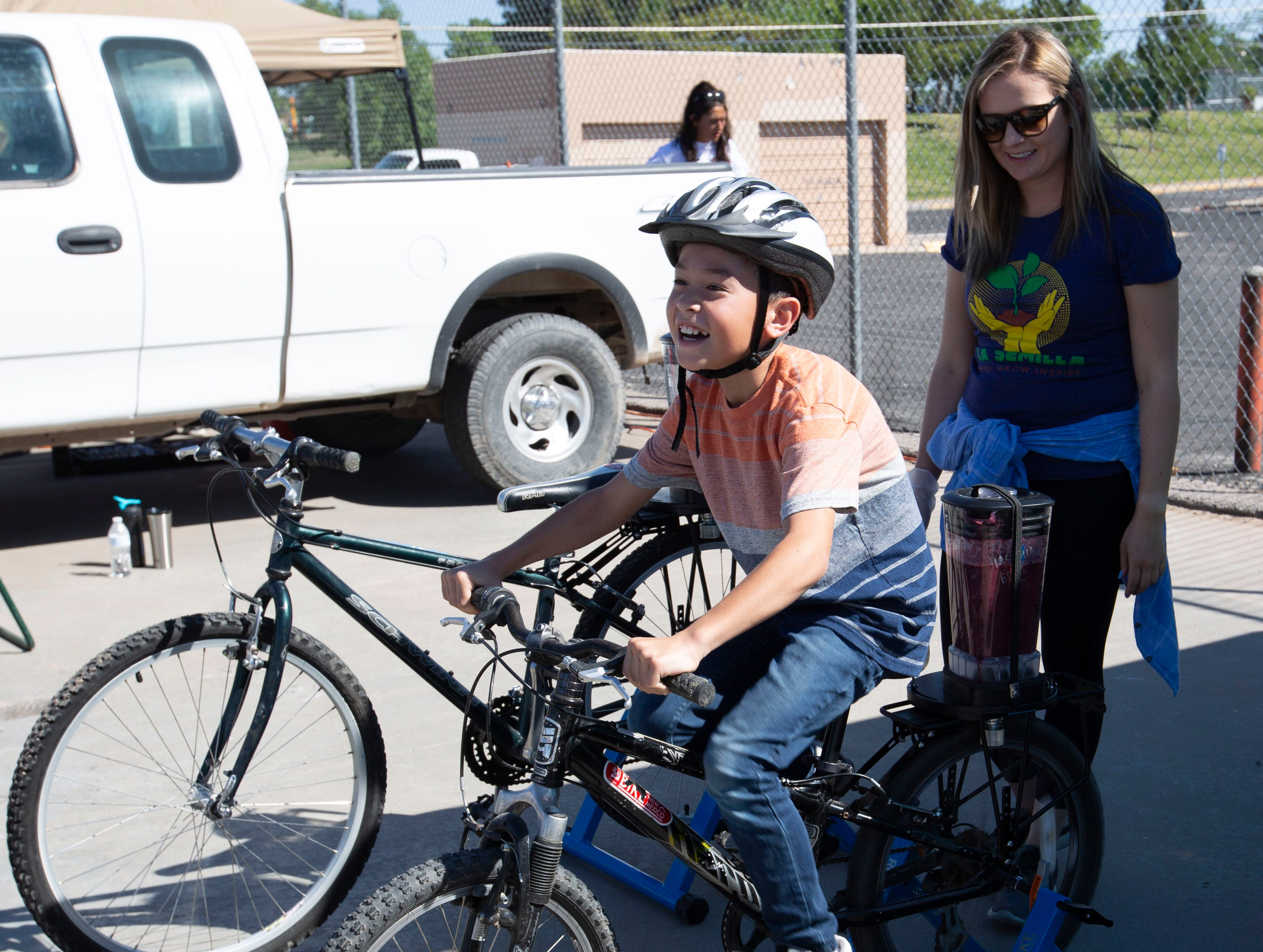 Waylon Yerxa, 10, spins as fast as he can to keep a blender full of smoothie goodness mixing on Saturday, April 27, 2019, at the Family Bike Fiesta.
