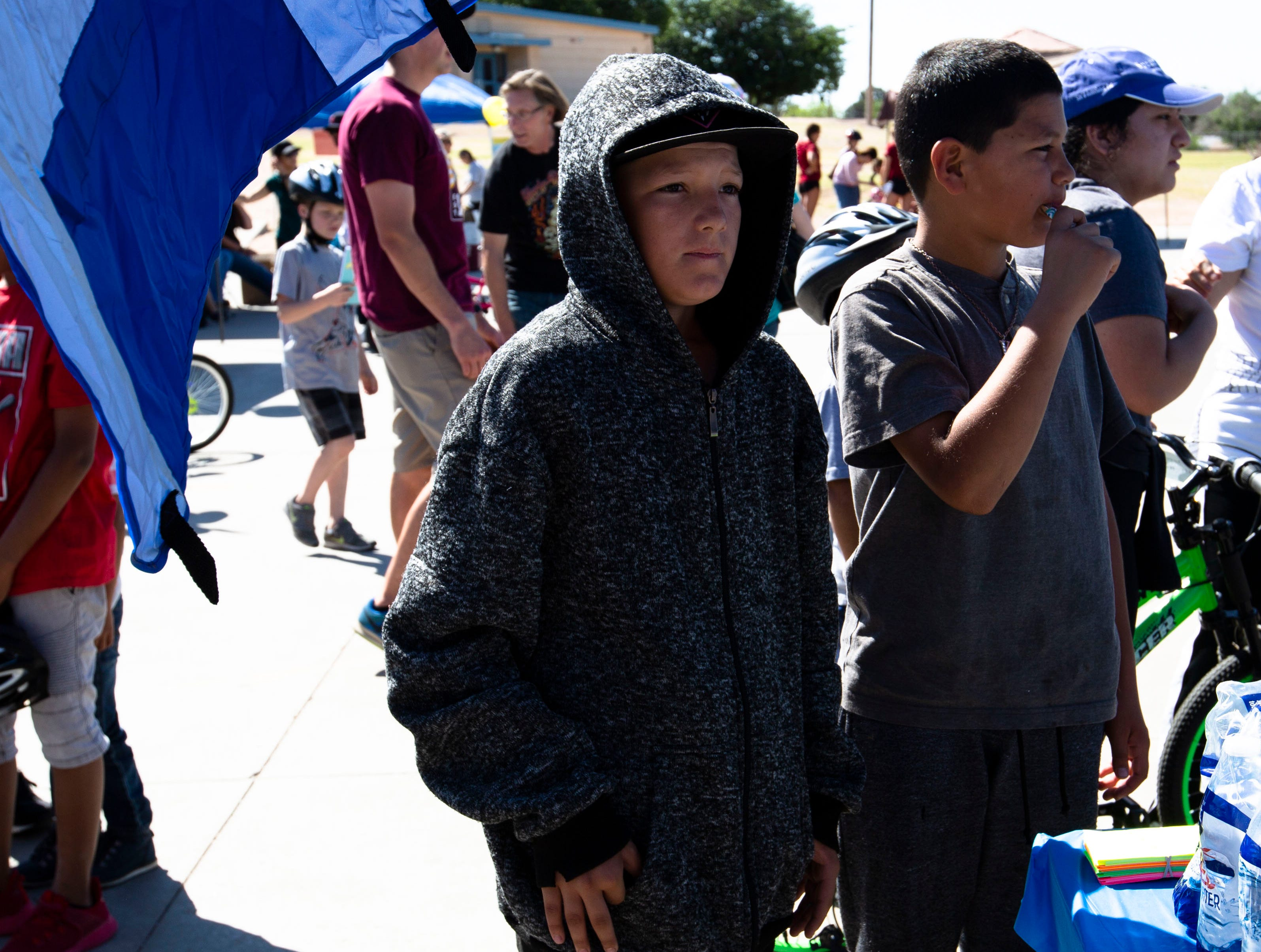 Alfonso Dominguez, 12, and Angelo Dominguez, 11, wait for their bikes to be repaired at the Family Bike Fiesta on Saturday, April 27, 2019