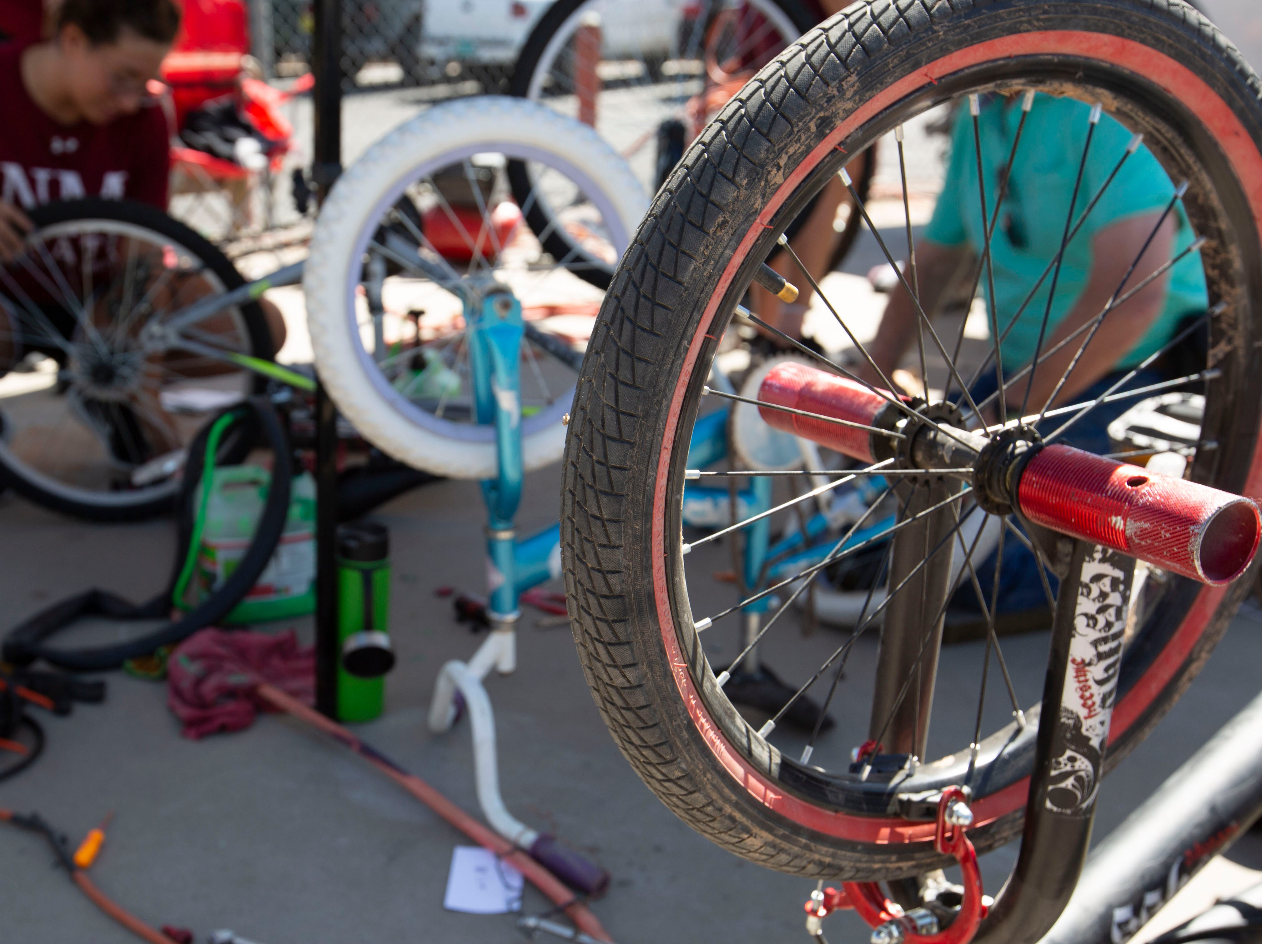 """The """"bike triage"""" corner at the Family Bike Fiesta was busy with bikes waiting to be repaired by volunteers on Saturday April 27, 2019."""