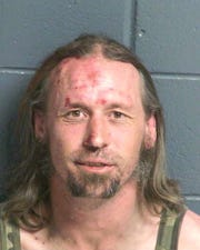 Royce Feuge, 38, is charged with aggravated assault with a deadly weapon, and resisting and evading arrest.