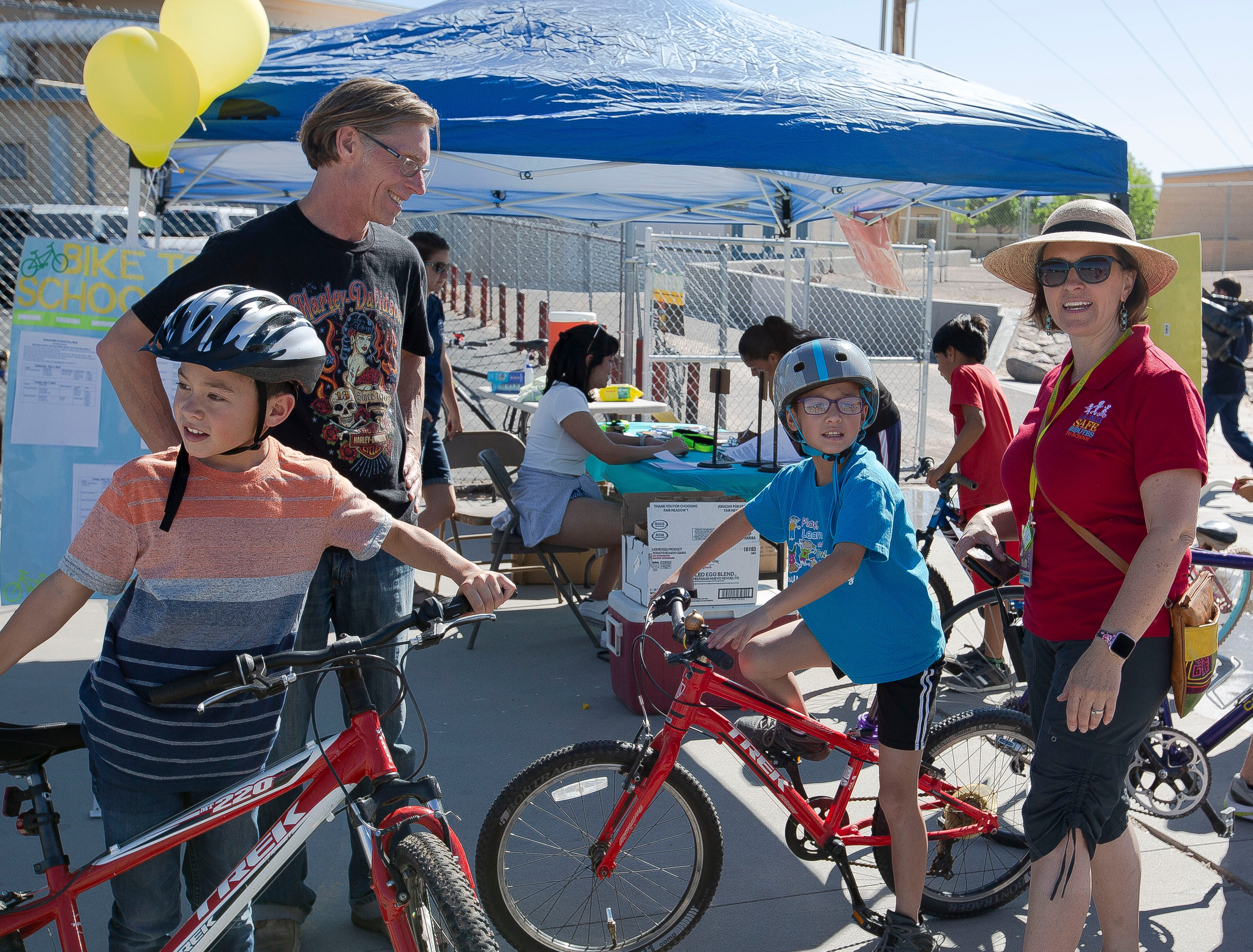 Waylon Yerxa, 10, and his twin sister Marley,  often bike to school together. Their father, Brad Yerxa, and Safe Routes to School Coordinator Ashleigh Curry, helped the children brush up on bicycle safety at the bike fiesta on Saturday, April 27, 2019.
