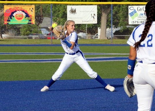 Carlsbad's Jennifer Munro throws to first base during Game 1 of Friday's doubleheader against Roswell. Carlsbad swept Roswell, run-ruling them in both games.