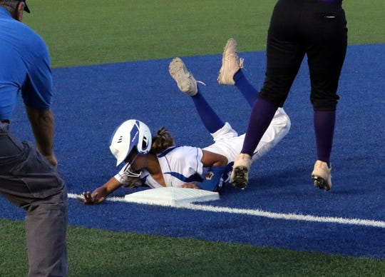 Carlsbad's Maddy Loera safely slides into third base during Game 1 of Friday's doubleheader. Carlsbad swept Roswell, run-ruling them in both games.