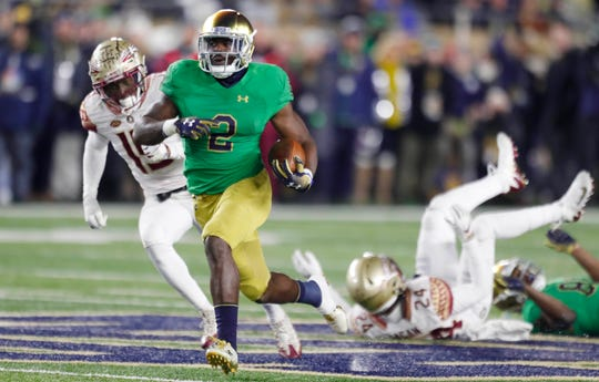 Notre Dame running back Dexter Williams scores on a 58-yard touchdown run against Florida State last November.