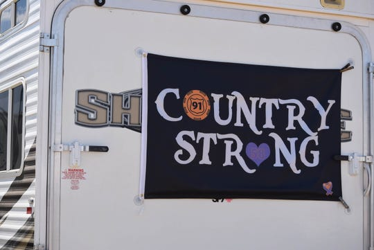 A banner hangs in remembrance in the campground at the Stagecoach country music festival in Indio, Calif. on April 26, 2019.
