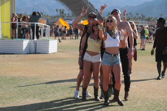 A group of friends take a selfie near the festival entrance at the Stagecoach country music festival, Indio, Calif., April 26, 2019.