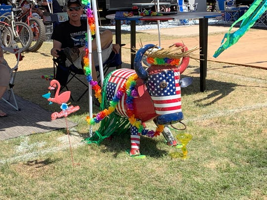 This metal bull doubles as a cooler at a campsite at the Stagecoach country music festival in Indio, Calif. on April 26, 2019.