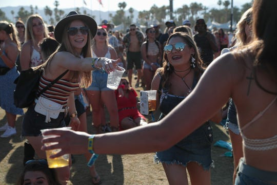 A group of friends dance during Russell Dickerson's performance at the Stagecoach country music festival, Indio, Calif., April 26, 2019.