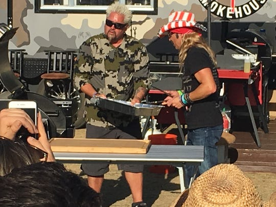 Guy Fieri takes Bret Michaels to flavortown at Guy's Stagecoach Smokehouse at Stagecoach country music festival in Indio, Calif., on April 26, 2019.