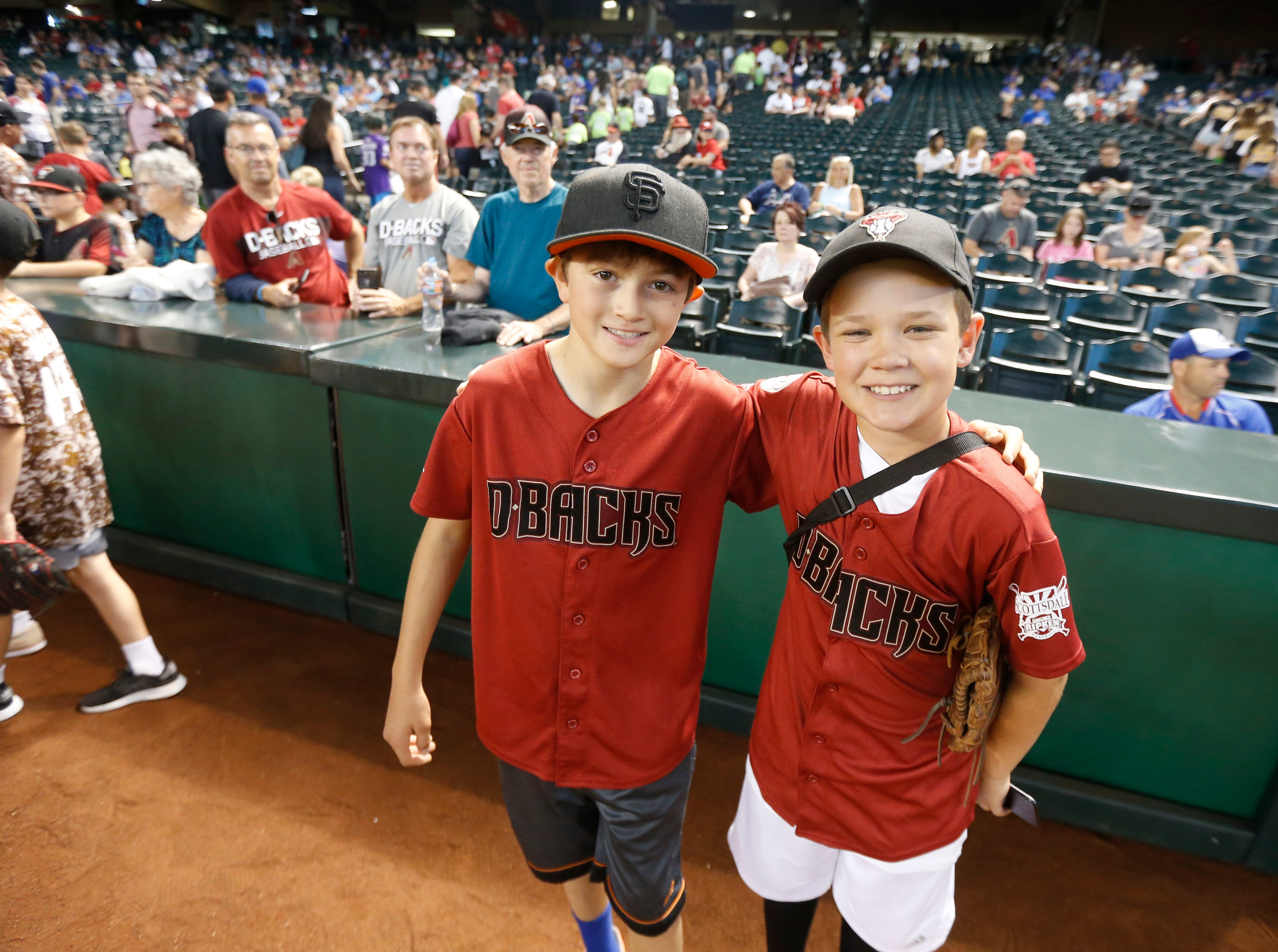 Young Diamondback fans pose for a picture during the Arizona All-Stars Parade before a Cubs vs. Diamondbacks game at Chase Field in Phoenix, Ariz. on April 26, 2019.