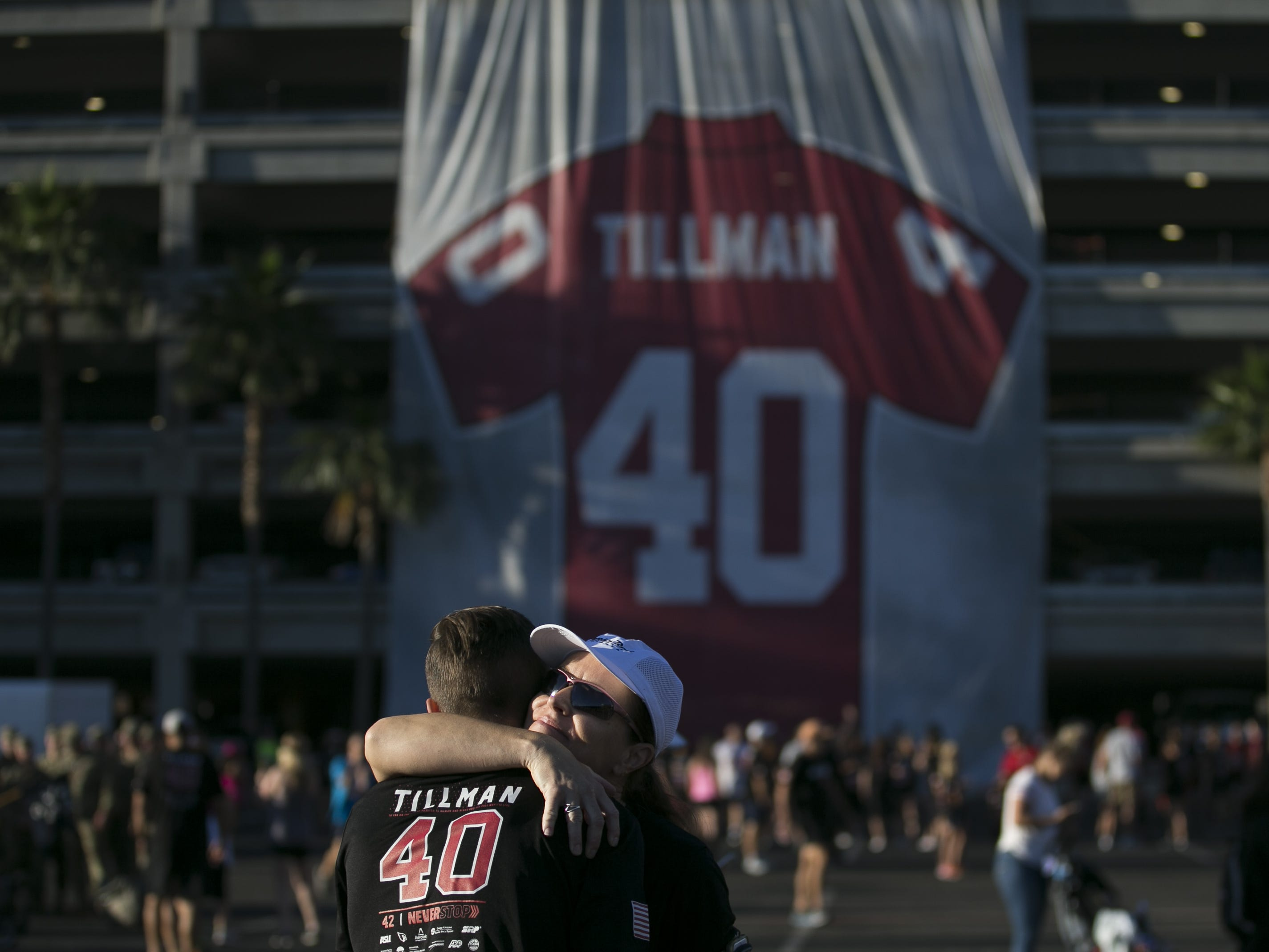 Carolyn Woods (right) hugs her 15-year-old son Justin George (left) before running in Pat's Run 2019 in Tempe on April 27, 2019.