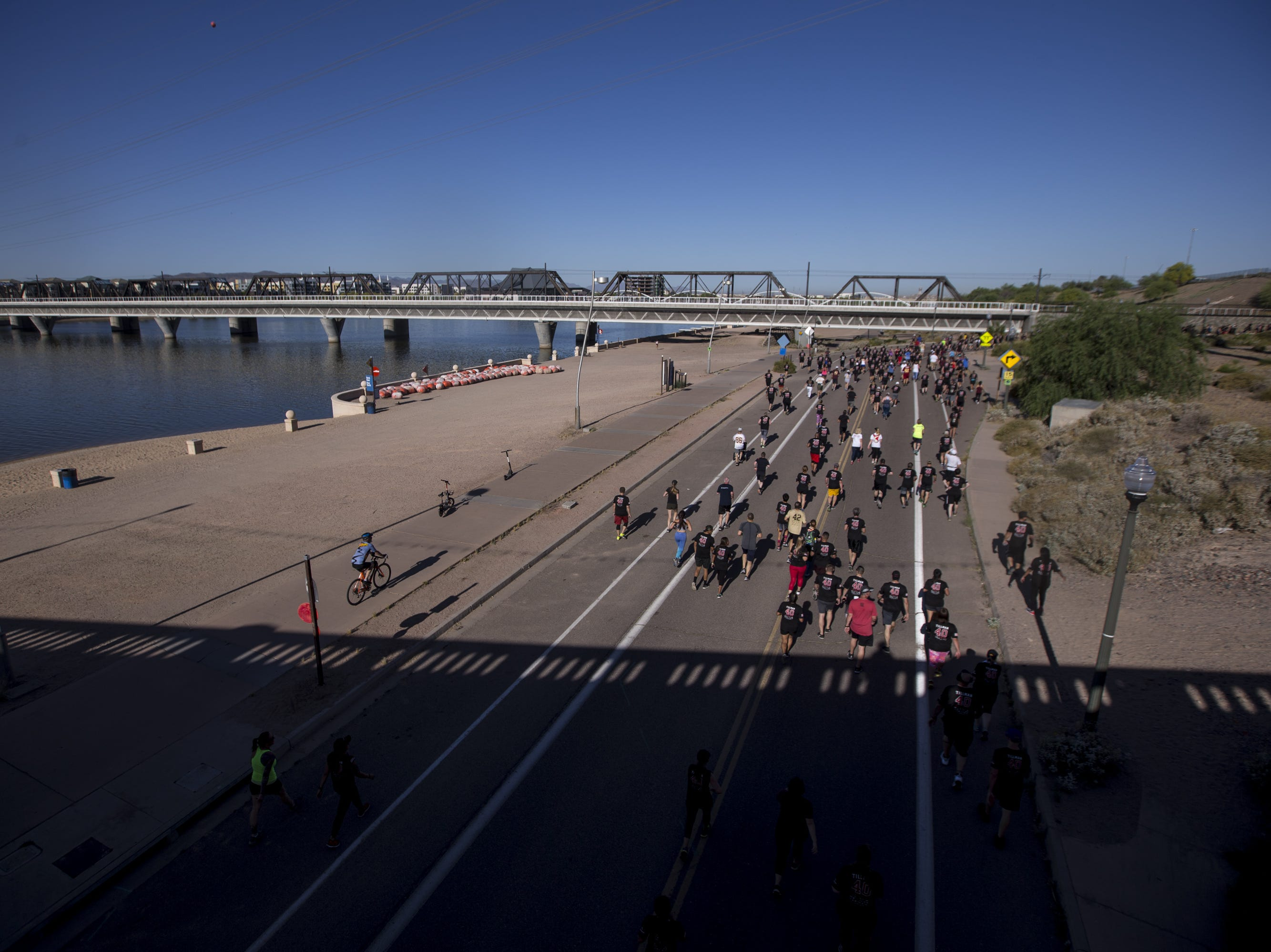 Participants run on Lake View Drive during the 15th Annual Pat's Run on Saturday, April 27, 2019, in Tempe, Ariz.
