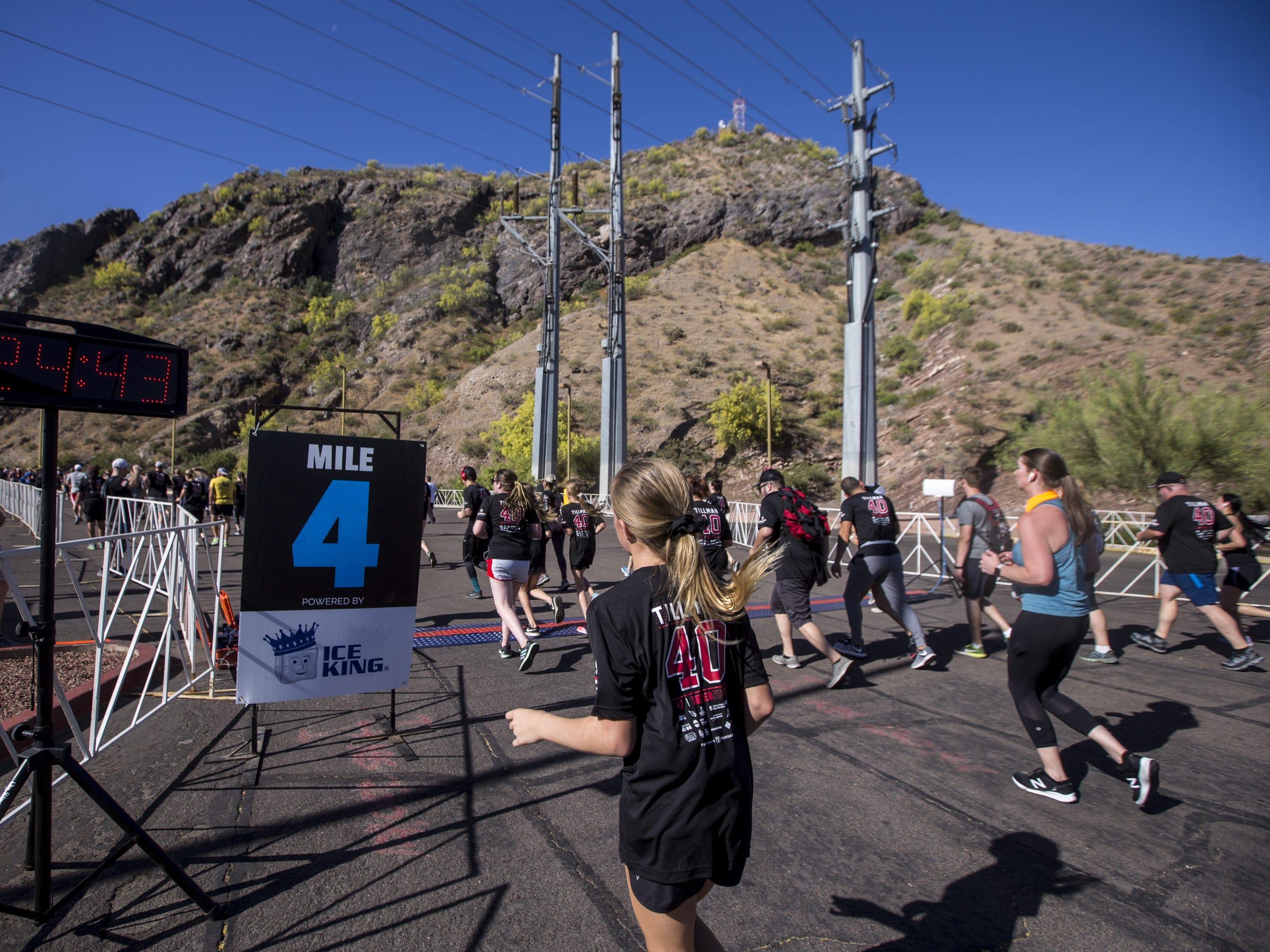 Participants run toward Sun Devil Stadium during the 15th Annual Pat's Run on Saturday, April 27, 2019, in Tempe, Ariz.